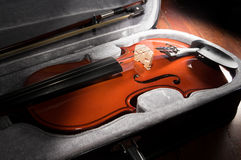Wooden violin in black case. Royalty Free Stock Photos