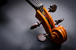 Wooden violin head Stock Images