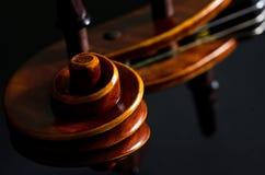 Wooden violin head Royalty Free Stock Photo