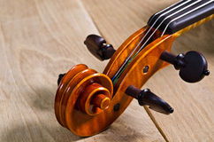 Wooden violin head Stock Photos