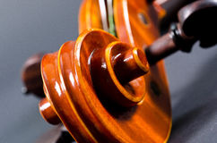 Wooden violin head Stock Photo