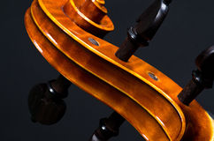 Wooden violin head Stock Photo