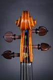 Wooden violin head Stock Photos