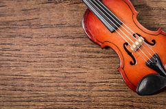 Wooden violin stringed instrument on old wooden. Stock Photography