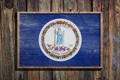 Wooden Virginia flag. 3d rendering of a Virginia State USA flag on a wooden frame and a wood wall Royalty Free Stock Photography