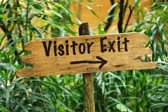 Wooden visitor exit sign board Stock Image