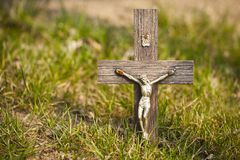 Wooden votive crucifixes in grass. Royalty Free Stock Photo