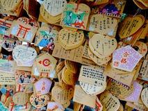 Wooden votive plaque Ema`s hanging at Tsuyunoten Shrine stock images
