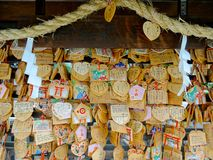 Wooden votive plaque Ema`s hanging at Tsuyunoten Shrine stock photo