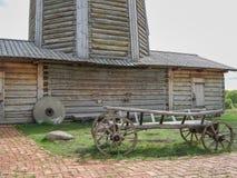 Wooden waggon near windmill Royalty Free Stock Photo