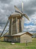 Wooden waggon near windmill Royalty Free Stock Photos