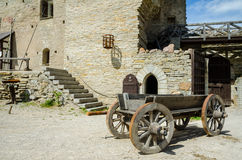 Wooden wagon in front of a wall of the castle Royalty Free Stock Images