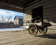 A Wooden Wagon. A wagon made of wood sits on a wood floor in a barn Royalty Free Stock Image