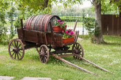 Wooden wagon. Old wooden wagon with old wooden keg in a garden Stock Photo
