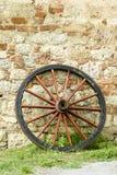 Wooden wagon wheel Stock Photo