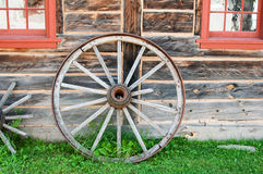 Wooden wagon wheel Stock Images