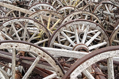 Wooden wagon wheels. Huge collection of old wooden wagon wheels Stock Photo