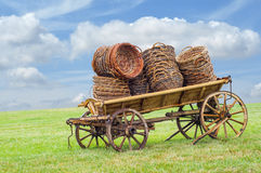 Wooden wain with baskets Stock Image