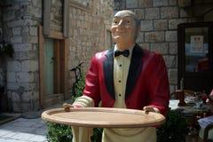 Wooden waiter. Near the restaurant Royalty Free Stock Image
