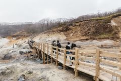Wooden walk way at Noboribetsu Jigokudani Hell Valley: The volcano valley got its name from the sulfuric smell. Wooden walk way at Noboribetsu Jigokudani Hell royalty free stock image