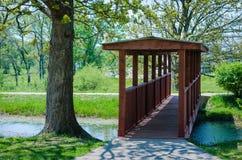 Wooden walking bridge over water Stock Photos