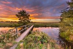 Wooden walking bridge at sunset Royalty Free Stock Images
