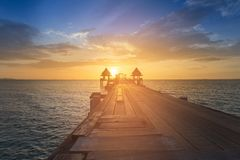 Wooden walking path leading to ocean skyline with beauty of sunset Royalty Free Stock Images