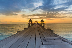 Wooden walking way leading to seacoast to abandon temple Stock Image