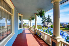 Wooden walkout porch of craftsman American house in blue tones Royalty Free Stock Photography