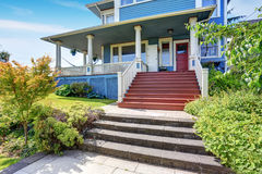 Wooden walkout porch of craftsman American house in blue tones Royalty Free Stock Photos