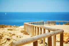 Wooden walkway along the coastline in Algarve region Royalty Free Stock Image