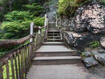 Wooden walkway approaching Bushkill Falls waterfall in the Poconos in Pennsylvania Stock Image