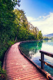 Wooden walkway around the lake Bled Royalty Free Stock Image