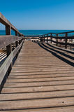 Wooden walkway on beach Stock Photo