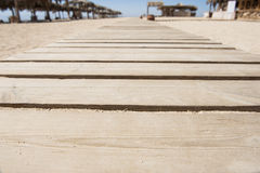 Wooden walkway on a beach Royalty Free Stock Photo