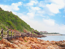 Wooden walkway bridge with mountain landscape  against blue sky Stock Image