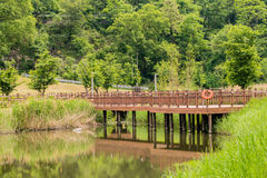 Wooden walkway and bridge over a river Stock Images