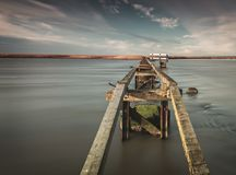 Wooden walkway on the coast royalty free stock photography