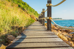 Wooden walkway beside the coast. Royalty Free Stock Image