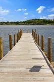 Wooden walkway at a lake Stock Image