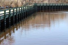 Plaxton Lake walkway at Moose Jaw Saskatchewan. Wooden walkway lakefront MooseJaw pattern lake calm water spring look shape Saskatchewan Canada Royalty Free Stock Image