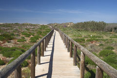 Wooden walkway leading to Bordeira Beach, Algarve,  Portugal Royalty Free Stock Photography
