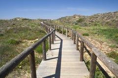 Wooden walkway leading to Bordeira Beach, Algarve,   Stock Photography