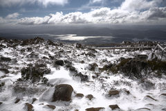 Wooden walkway at Mount Wellington. Mount Wellington in the winter; dramatic and moody cloudscape overhead Stock Photo