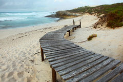 Wooden walkway onto beach. With sea in background royalty free stock images