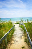 Wooden walkway over dunes at beach Royalty Free Stock Image