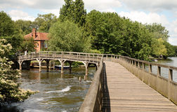 Wooden walkway over the River Thames Royalty Free Stock Images