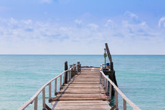 Wooden walkway path leading to the sea Royalty Free Stock Photography