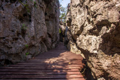 Wooden walkway between the rocks Stock Images