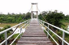 Wooden walkway of the rope bridge Royalty Free Stock Image